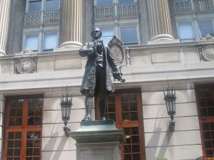 Hamilton statue at Columbia, an early American rock in the sea of finance.