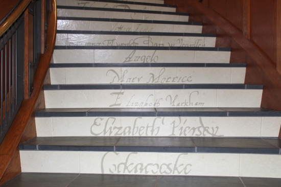 2018-11-09-TENACITY-exhibit-Names-of-Women-on-exhibit-stairway